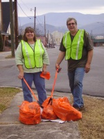 Two people cleaning a road side for Keep Chatsworth-Murray Beautiful